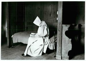 (1985) A Carthusian choir monk sits alone, reading in his cell, at St. Hugh's Charterhouse monastery in Sussex, England. Religion News Service file photo by Colin Horsman